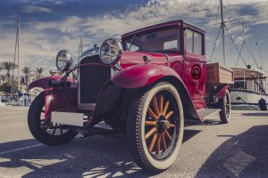 Vintage car at port.
